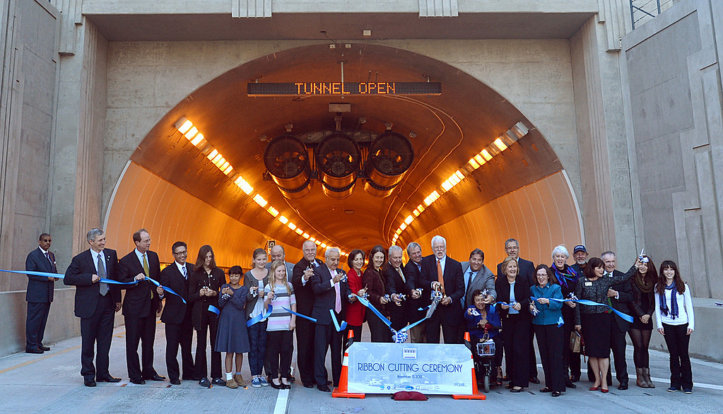 . Officals and special guests line up in front of the new Caldecott Fourth Bore Tunnel for the official ribbon cutting in Orinda, Calif., on Friday, Nov. 15, 2013. The new bore will officially open tomorrow to traffic. (Dan Rosenstrauch/Bay Area News Group)