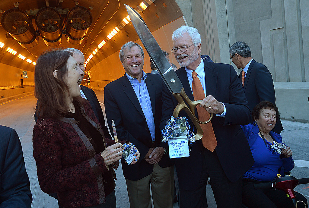 . US Congressman George Miller holds up the official ribbon cutting scissors as California Assembly Member Nancy Skinner and California State Senator Mark DeSaulnier, center, share a laugh after the official ribbon cutting ceremony for the opening of the new Caldecott Fourth Bore tunnel in Orinda, Calif., on Friday, Nov. 15, 2013. The new bore will officially open tomorrow to traffic. (Dan Rosenstrauch/Bay Area News Group)