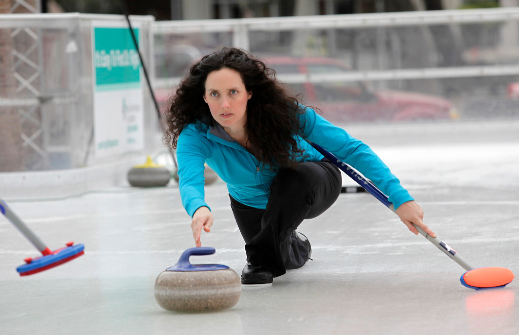 . Gabrielle Coleman of the San Francisco Bay Area Curling Club delivers a stone during a demonstration at Downtown Ice in San Jose, Calif. on Monday, January 6, 2014. With the Winter Olympic games at Sochi just weeks away, the local club wants to build awareness in the international sport. Coleman has competed on a national level at the 2009 Olympic trials. (Gary Reyes/Bay Area News Group)