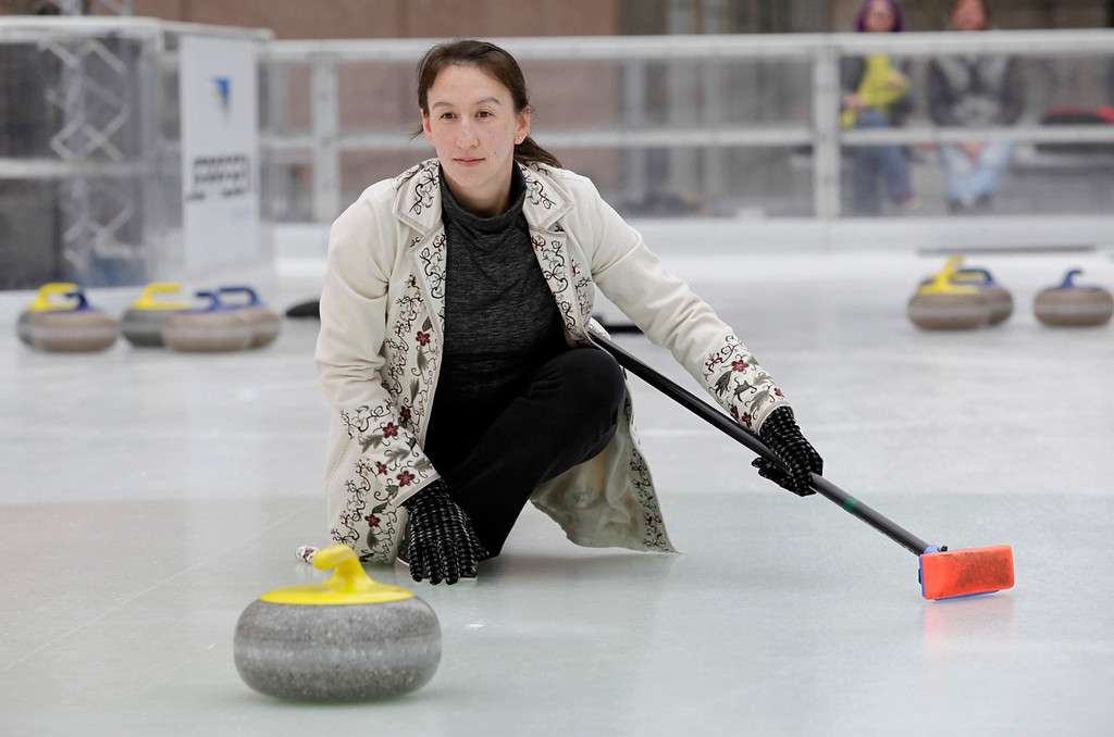 . Davinna Kong of the San Francisco Bay Area Curling Club delivers a stone during a demonstration at Downtown Ice in San Jose, Calif. on Monday, January 6, 2014. With the Winter Olympic games at Sochi just weeks away, the local club wants to build awareness in the international sport. Kong competes at the club level and national level. (Gary Reyes/Bay Area News Group)
