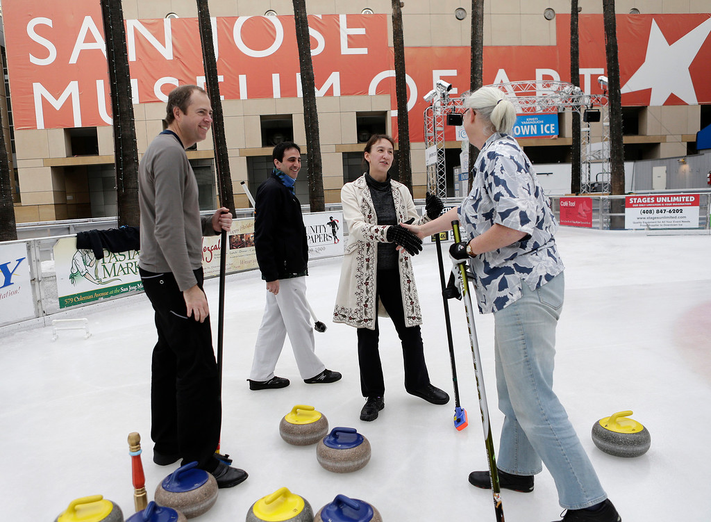 . Local members of the San Francisco Bay Area Curling Club give out time-honored handshakes following a match after demonstrating the sport of curling at Downtown Ice in San Jose, Calif. on Monday, January 6, 2014. Left to right are Stephen Marschall, Richard Lazarowich, Davinna Kong and Alice Mansell. With the Winter Olympic games at Sochi just weeks away, the local club wants to build awareness in the international sport. (Gary Reyes/Bay Area News Group)