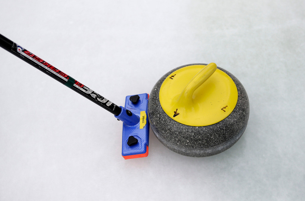 . A curling broom pushes a stone off  the ice as the San Francisco Bay Area Curling Club demonstrates the sport of curling at Downtown Ice in San Jose, Calif. on Monday, January 6, 2014. The typical stone weighs about 40 pounds. With the Winter Olympic games at Sochi just weeks away, the local club wants to build awareness in the international sport. (Gary Reyes/Bay Area News Group)