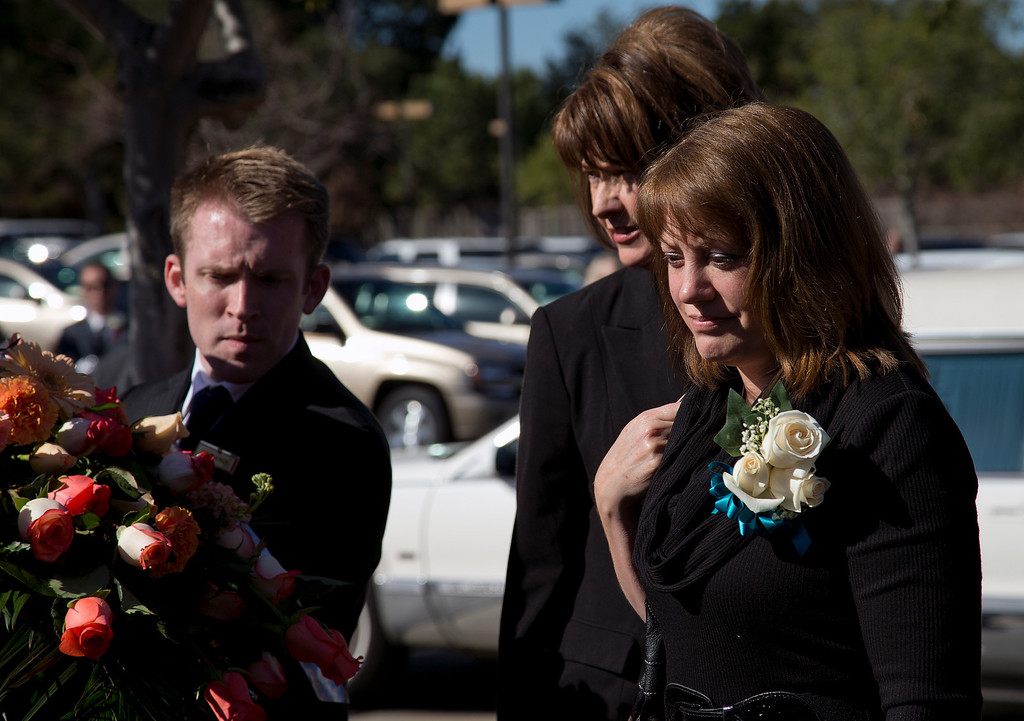 . At left, Dale Smith\'s wife, Janis Smith watches as a casket is placed into a hearse after the funeral for her husband and four family members at the LDS Church in San Jose, Calif., on Saturday, Feb.1, 2014. A plane piloted by Dale Smith crashed on Dec. 1, 2013, carrying his daughter Amber Smith and her fiancee, Jonathan Norton; and son Daniel Smith and his wife, Sheree.  (LiPo Ching/Bay Area News Group)
