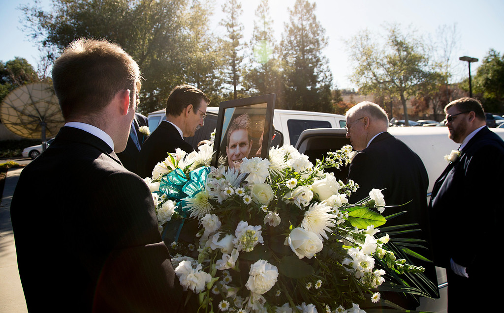 . Flowers on the casket of Silicon Valley tech executive and avid pilot Dale Smith are placed in the hearse after the funeral for Smith and four family members at the LDS Church in San Jose, Calif., on Saturday, Feb.1, 2014.  A plane piloted by Smith crashed on Dec. 1, 2013 carrying his daughter Amber Smith and her fiancee, Jonathan Norton; and son Daniel Smith and his wife, Sheree.  (LiPo Ching/Bay Area News Group)