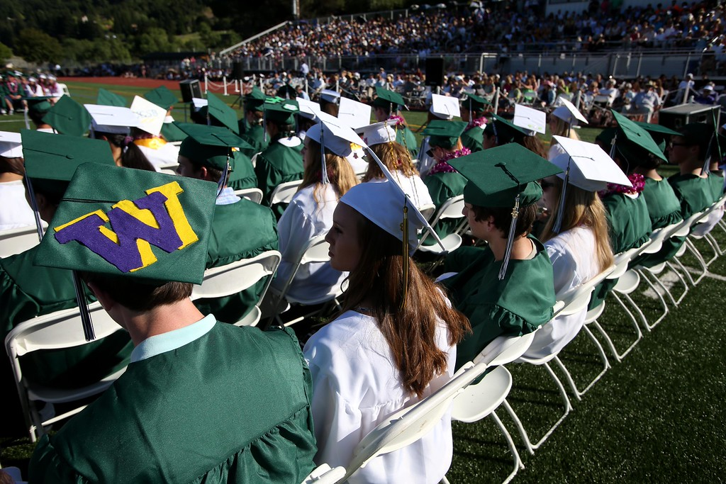 . Graduates listen to speakers during Miramonte High School\'s 54th commencement ceremony in Orinda, Calif., on Friday, June 7, 2013. (Jane Tyska/Bay Area News Group)