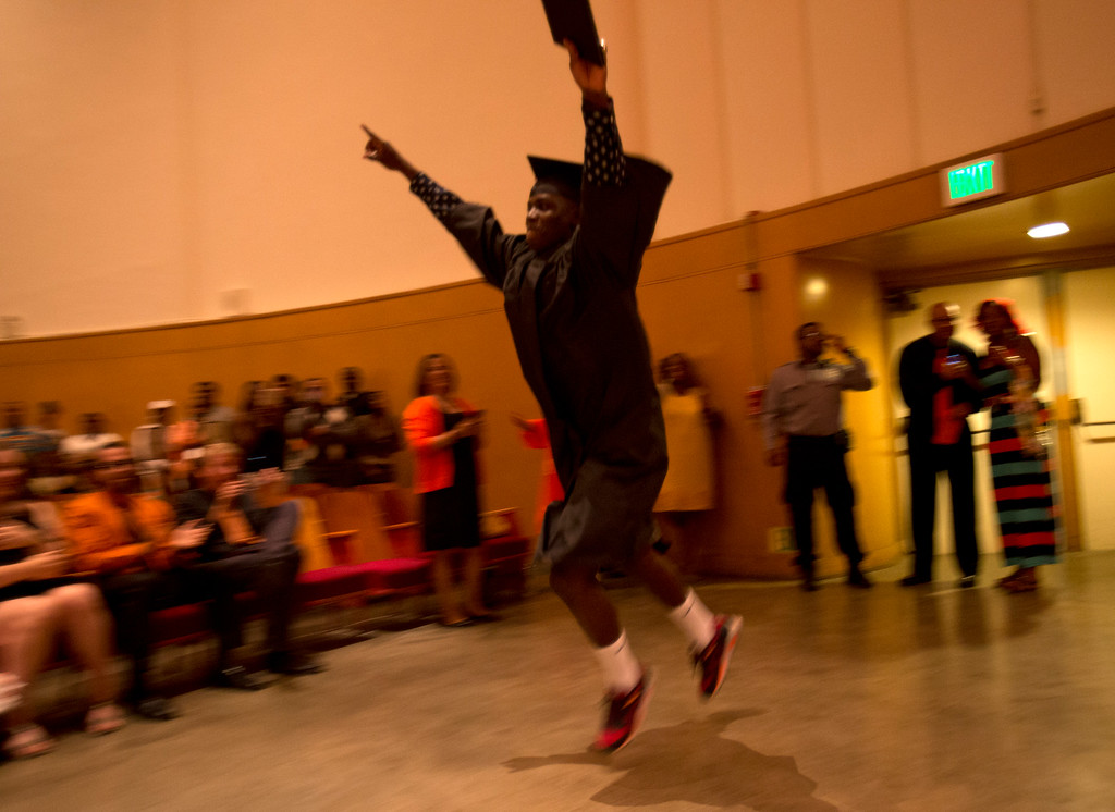 . A member of the Class of 2013 exults after receiving his diploma during the graduation ceremonies at McClymonds High School, Thursday, June 13, 2013 in Oakland, Calif. (D. Ross Cameron/Bay Area News Group)
