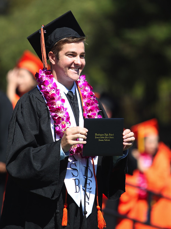 . Kyle O\'Hallaren, 18, Washington High School Class of 2013 graduate and student body president poses for a photograph after receiving his diploma during school\'s commencement ceremony in Fremont, Calif., on Wednesday, June 19, 2013. (Anda Chu/Bay Area News Group)