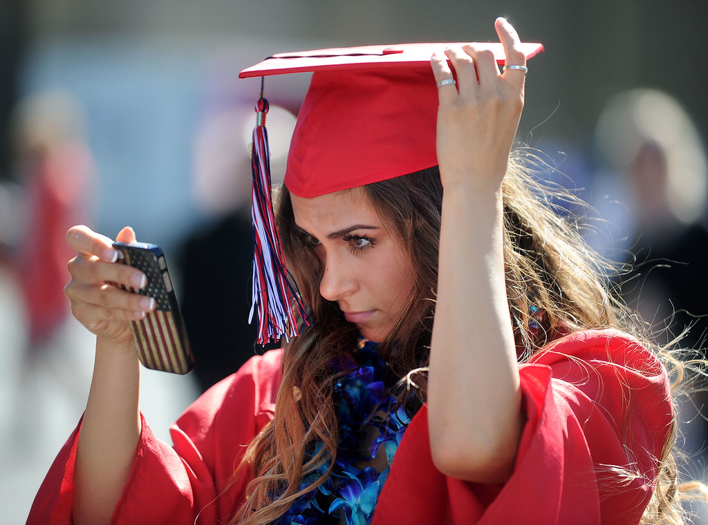 . Dublin High graduate Erika Ramirez, adjusts her mortarboard before the start of their Commencement Ceremony held at the Alameda County Fairgrounds in Pleasanton, Calif., on Thursday, June 13, 2013. (Doug Duran/Bay Area News Group)