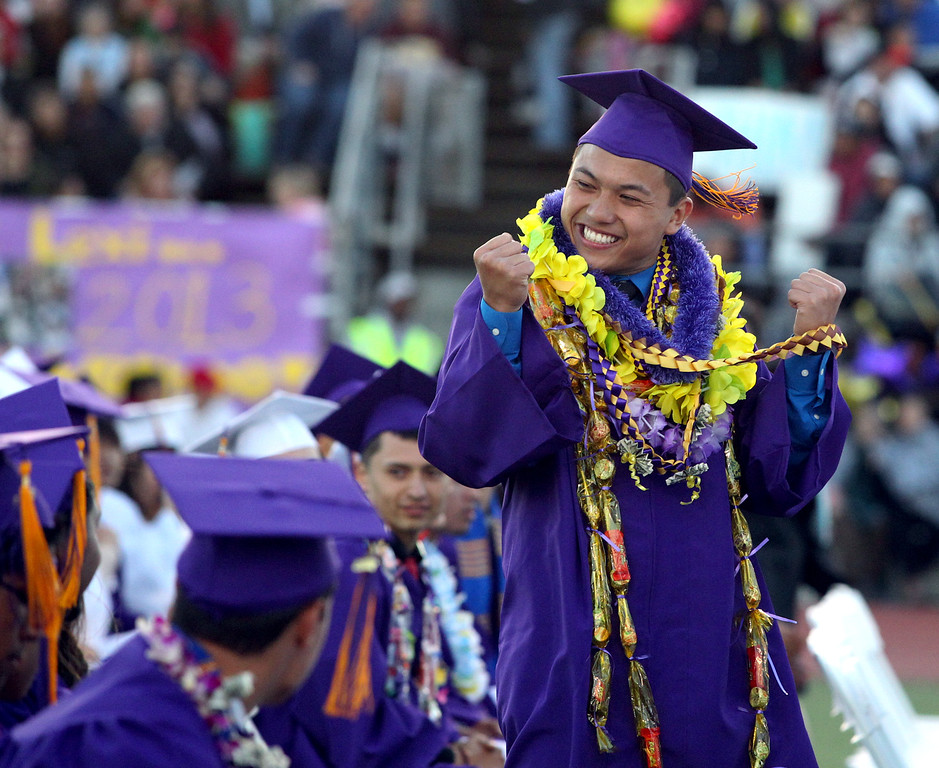 . Thien Phan, 18, Kennedy High School graduate celebrates as he waits to receive his diploma during the school\'s commencement ceremony in Fremont, Calif., on Wednesday, June 19, 2013. (Anda Chu/Bay Area News Group)