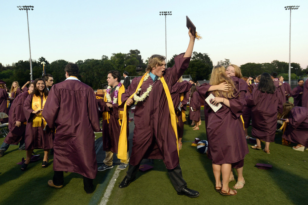 . Max Buschini, center, lets out a yell at the end of the 2013 Las Lomas High School Commencement held on the Las Lomas High School campus in Walnut Creek, Calif. on Friday, June 7, 2013. (Dan Honda/Bay Area News Group)