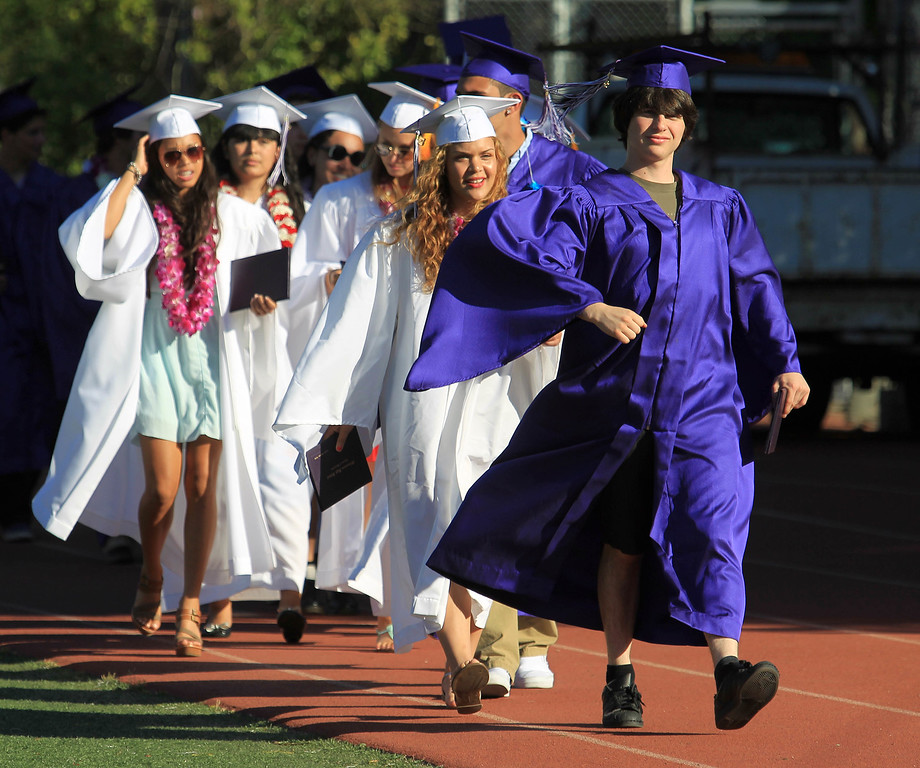 . Lennon Feiger, right, leads the class of 2013 in a traditional lap around Witter Field at the conclusion of commencement ceremonies at Piedmont High School in Piedmont, Calif., on Thursday, June 13, 2013.  (Jane Tyska/Bay Area News Group)