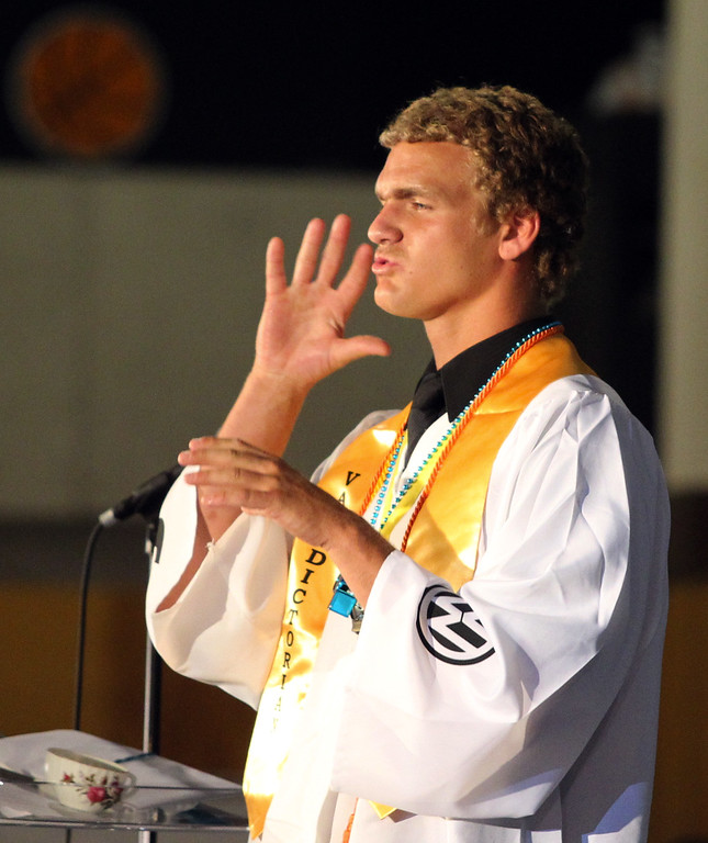 . Class of 2013 graduate and Valedictorian Jacy Pedersen, 18, of Union City, delivers his speech in American Sign Language during California School for the Deaf\'s graduation ceremony in Fremont, Calif., on Friday, June 7, 2013. Forty seniors make up the school\'s 141st CSD graduating class. (Anda Chu/Bay Area News Group)