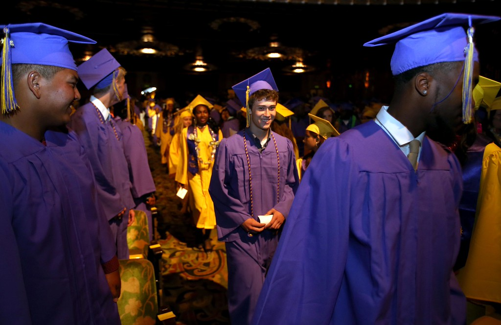 . Oakland Technical High School students march in during graduation ceremonies at the Paramount Theatre in Oakland, Calif., on Tuesday, June 11,  2013. The school graduated 351 students  in the class of 2013. (Jane Tyska/Bay Area News Group)