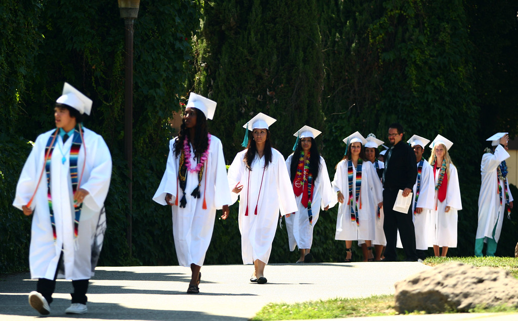 . Class of 2013 graduates march to their graduation ceremony at the California School for the Deaf in Fremont, Calif., on Friday, June 7, 2013. Forty seniors make up the school\'s 141st CSD graduating class. (Anda Chu/Bay Area News Group)