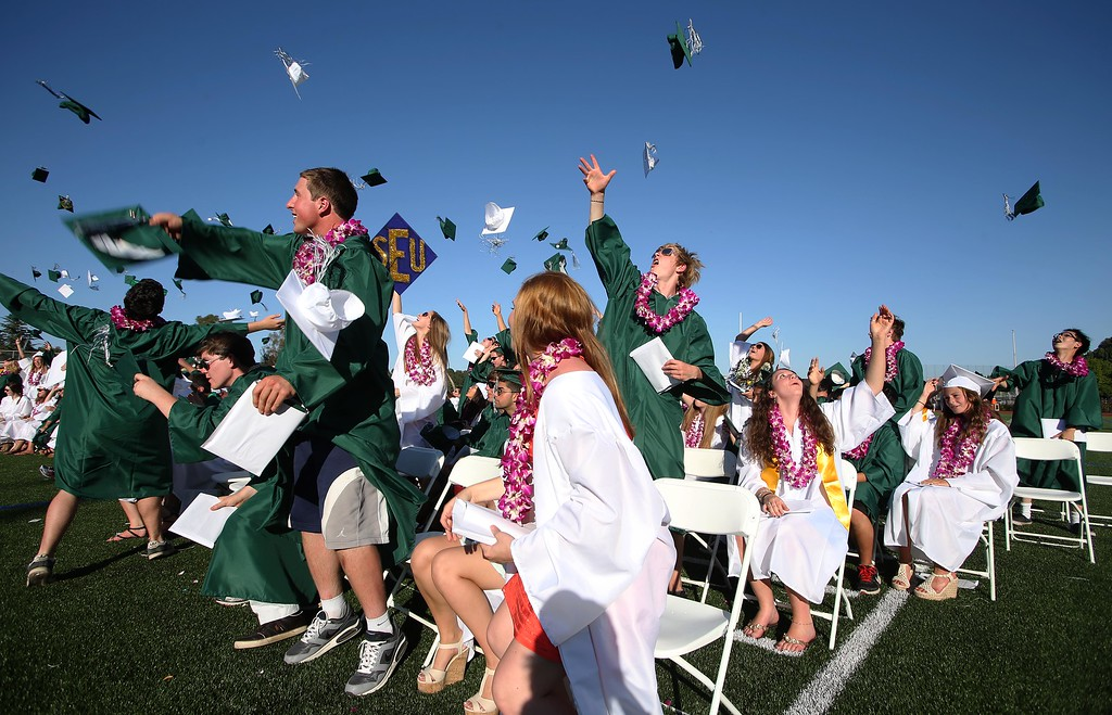 . Graduates toss their caps at the conclusion of Miramonte High School\'s 54th commencement ceremony in Orinda, Calif., on Friday, June 7, 2013. (Jane Tyska/Bay Area News Group)