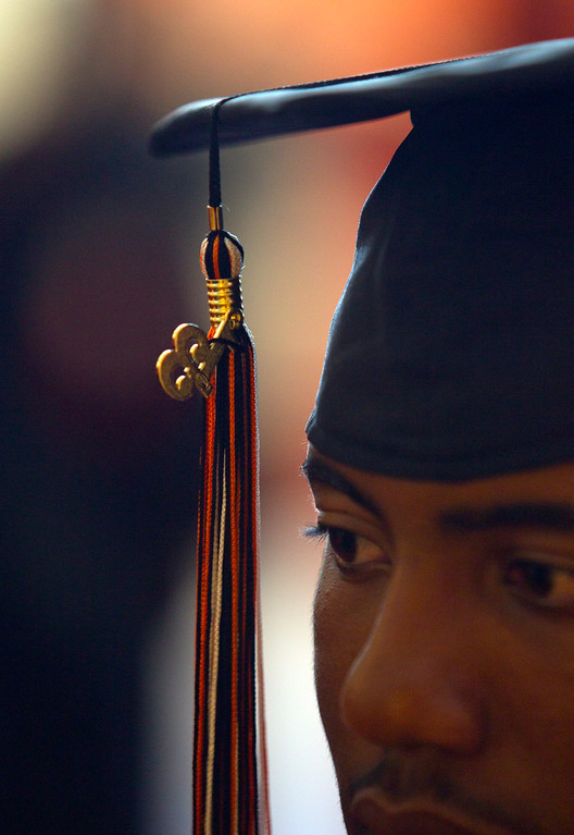 . Timothy Banks sports a 2013 tassel during the graduation ceremonies for the Class of 2013 at McClymonds High School, Thursday, June 13, 2013 in Oakland, Calif. (D. Ross Cameron/Bay Area News Group)