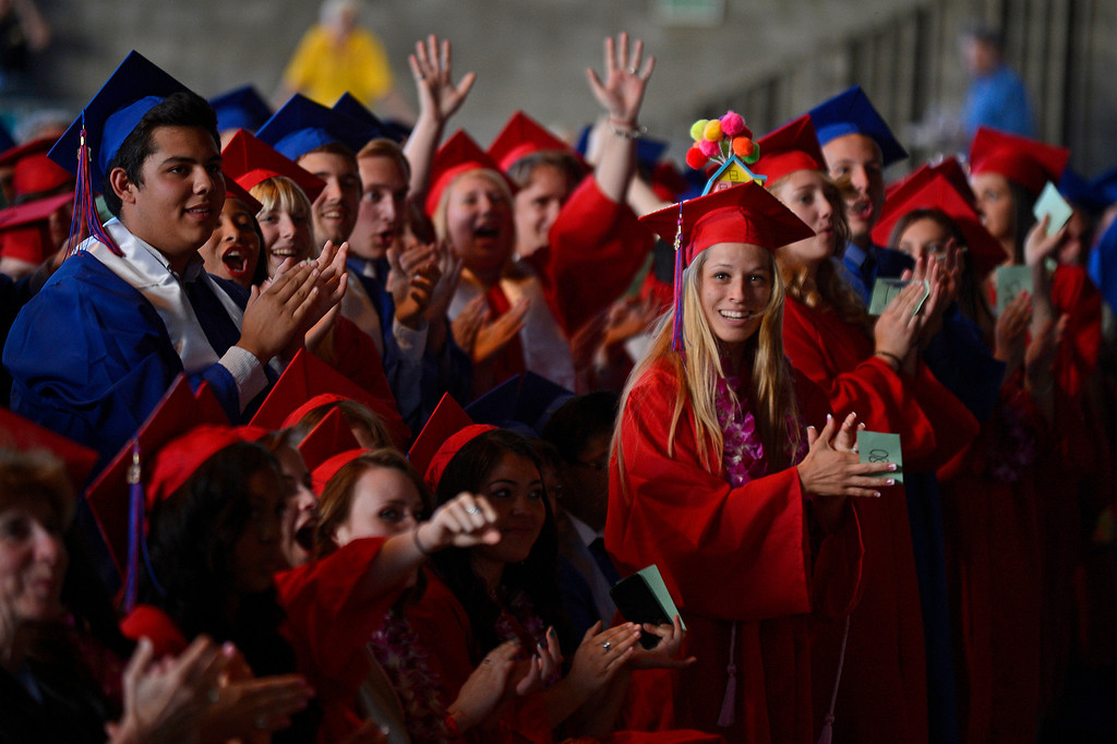 . Clayton Valley Charter High School students cheer for a student on stage during commencement ceremonies on Thursday, May 30, 2013 at Sleep Train Pavilion in Concord, Calif. (Jose Carlos Fajardo/Bay Area News Group)