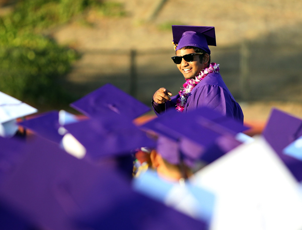 . Sai Sanigepalli Kennedy High School graduate and class valedictorian points to fellow graduates as he takes to the stage to give his address during their commencement ceremony in Fremont, Calif., on Wednesday, June 19, 2013. (Anda Chu/Bay Area News Group)