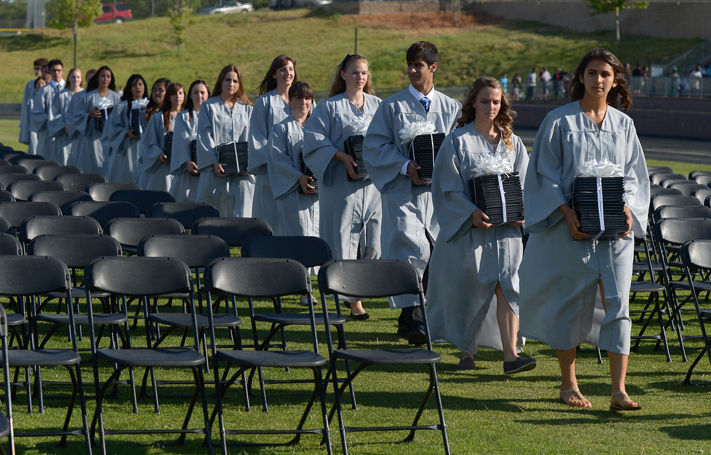 . Deer Valley High School junior class members deliver diploma covers to the stage during graduation ceremonies at Deer Valley High School in Antioch, Calif., on Thursday, June 6, 2013. (Jose Carlos Fajardo/Bay Area News Group)