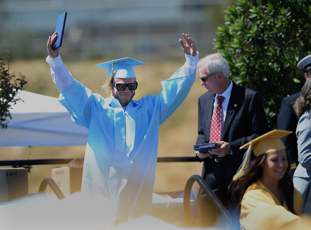 . Colin Wirth receives his diploma at the Heritage High School graduation ceremony held at Patriot Stadium on the campus of Heritage High School in Brentwood, Calif., on Saturday, June 8, 2013. (Dan Honda/Bay Area News Group)