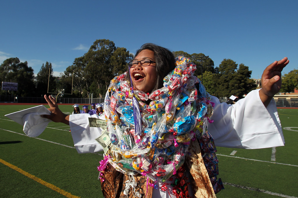 . Class of 2013 Speaker at Large Naakakala Kaufusi celebrates as her name is announced in the presentation of diplomas during the Castlemont High School graduation ceremony in Oakland, Calif., on Friday, June 14, 2013.  (Ray Chavez / Bay Area News Group)