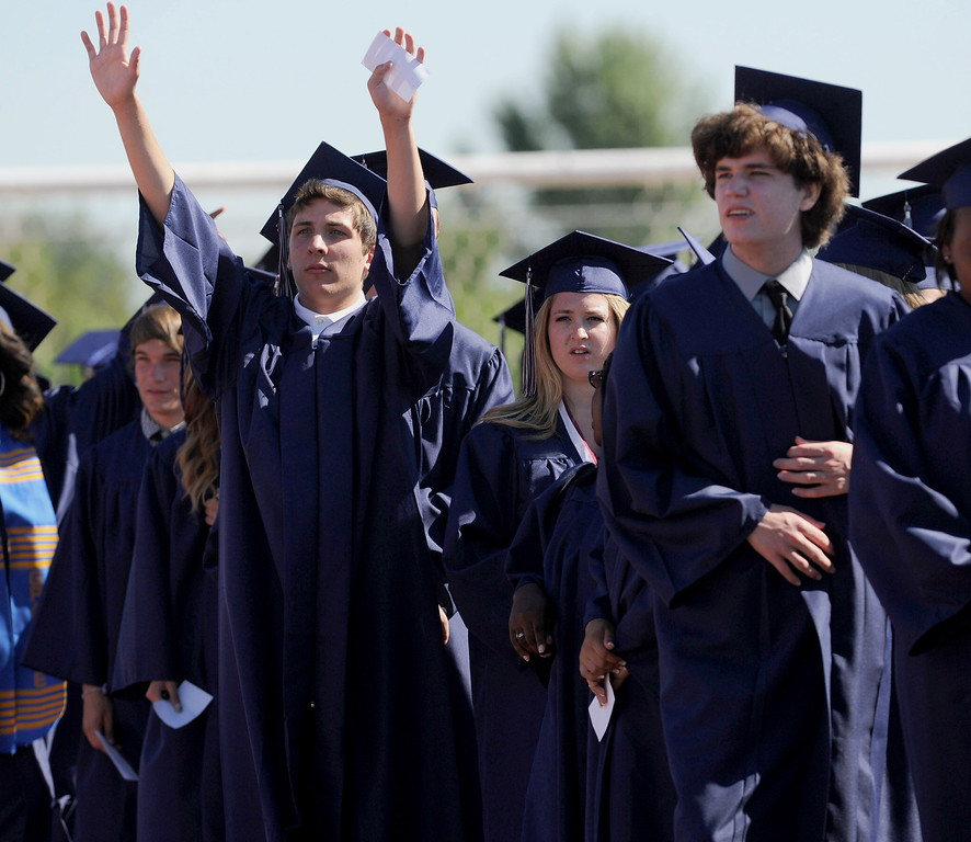 . As graduates enter they scan the crowd for family and friends at the Freedom High School graduation ceremony held at Falcon Stadium on the campus of Freedom High School in Oakley, Calif., on Saturday, June 8, 2013. (Dan Honda/Bay Area News Group)