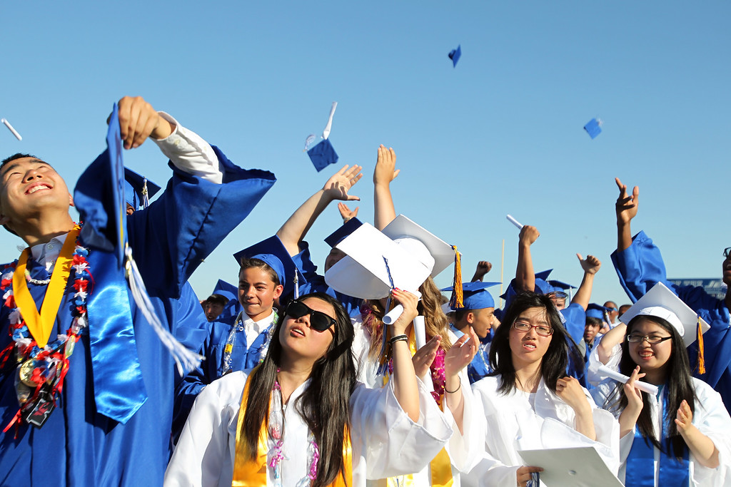 . Graduates of the Class of 2013 cheer and toss their caps up in the air at the conclusion of their graduation ceremony at Encinal High School in Alameda, Calif., on Friday, June 7, 2013.  (Ray Chavez / Bay Area News Group)
