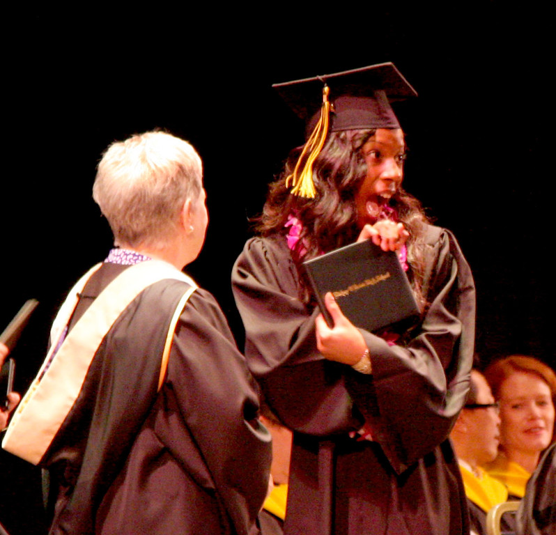 . Maya Williams reacts after receiving her diploma from Principal Pam Shay at the 59th commencement ceremonies of Bishop O\'Dowd High School at the Paramount Theatre of the Arts in Oakland, Calif. on Sunday, June 2, 2013. (Jim Stevens/Bay Area News Group)