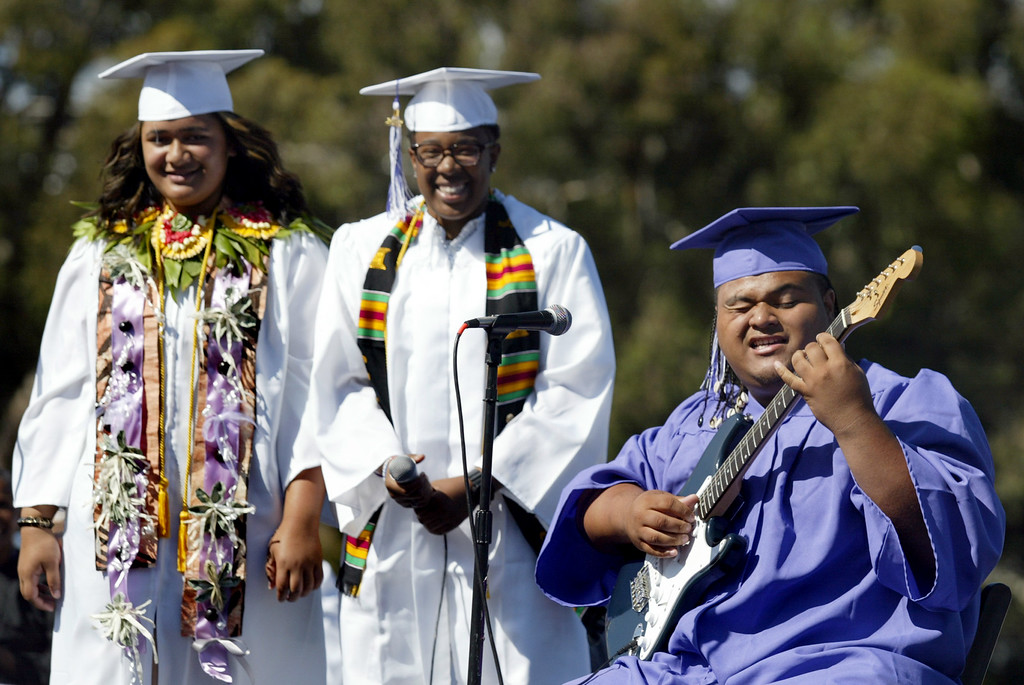 ". Seniors Ana Katoa, left, Dawn McCladdie and Westsomi Lapota sing ""Look How Far We\'ve Come\"" during the Castlemont High School graduation ceremony of the Class of 2013 in Oakland, Calif., on Friday, June 14, 2013. (Ray Chavez /Bay Area News Group)"