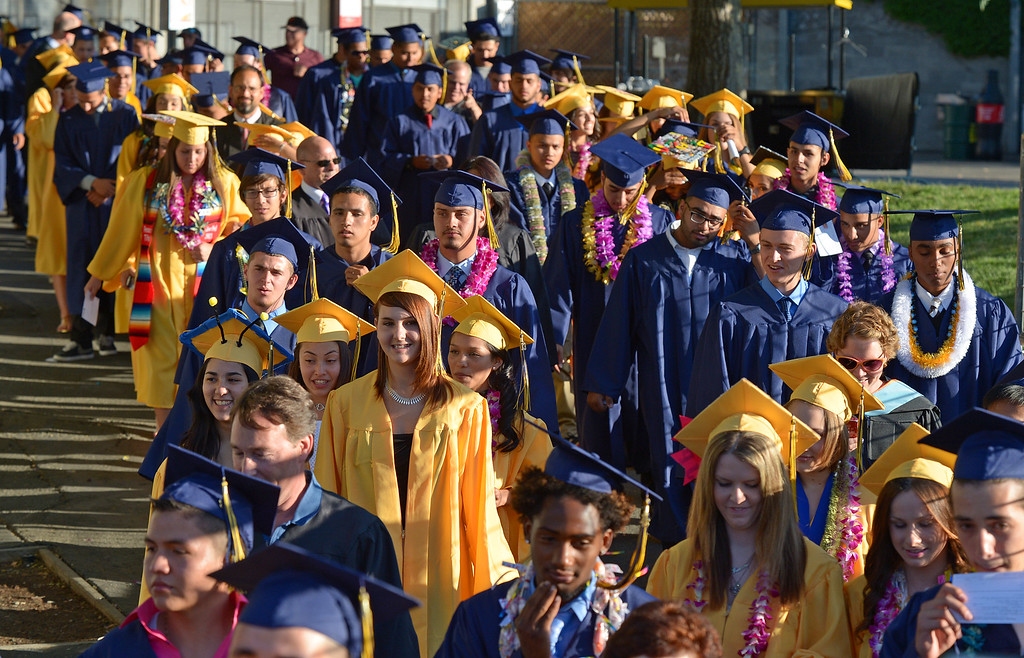 . Ygnacio Valley High School students walk towards the stage during commencement ceremonies at Sleep Train Pavilion in Concord, Calif., on Thursday, June 13, 2013. (Jose Carlos Fajardo/Bay Area News Group)