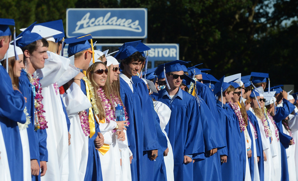 . Acalanes High School graduates stand in front of their seats during the start of their commencement ceremony in Lafayette, Calif., on Friday, June 7, 2013. The graduation featured speeches from graduates Edward Huddart and Carolyn Moore. (Doug Duran/Bay Area News Group)