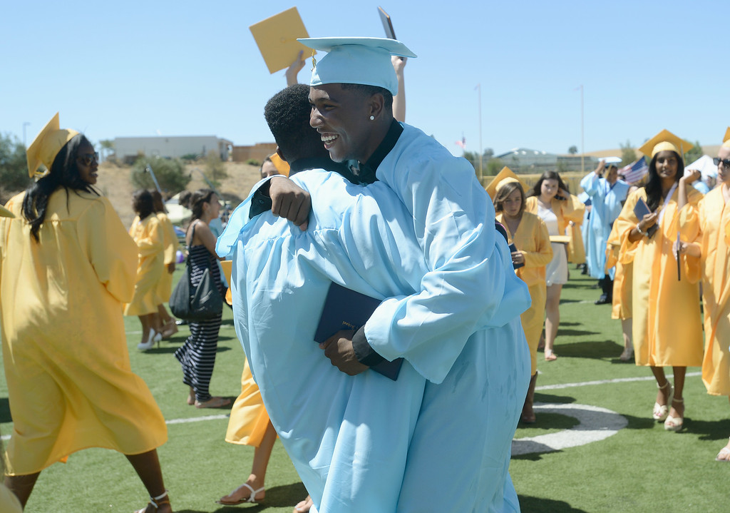 . Anthony Carter celebrates at the Heritage High School graduation ceremony held at Patriot Stadium on the campus of Heritage High School in Brentwood, Calif., on Saturday, June 8, 2013. (Dan Honda/Bay Area News Group)