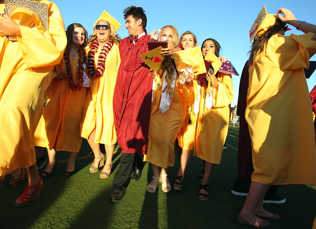 . Liberty High School Class of 2013 graduates walk off the school\'s Ohmstede Field after attending their commencement ceremony in Brentwood, Calif., on Friday, June 7, 2013. (Anda Chu/Bay Area News Group)