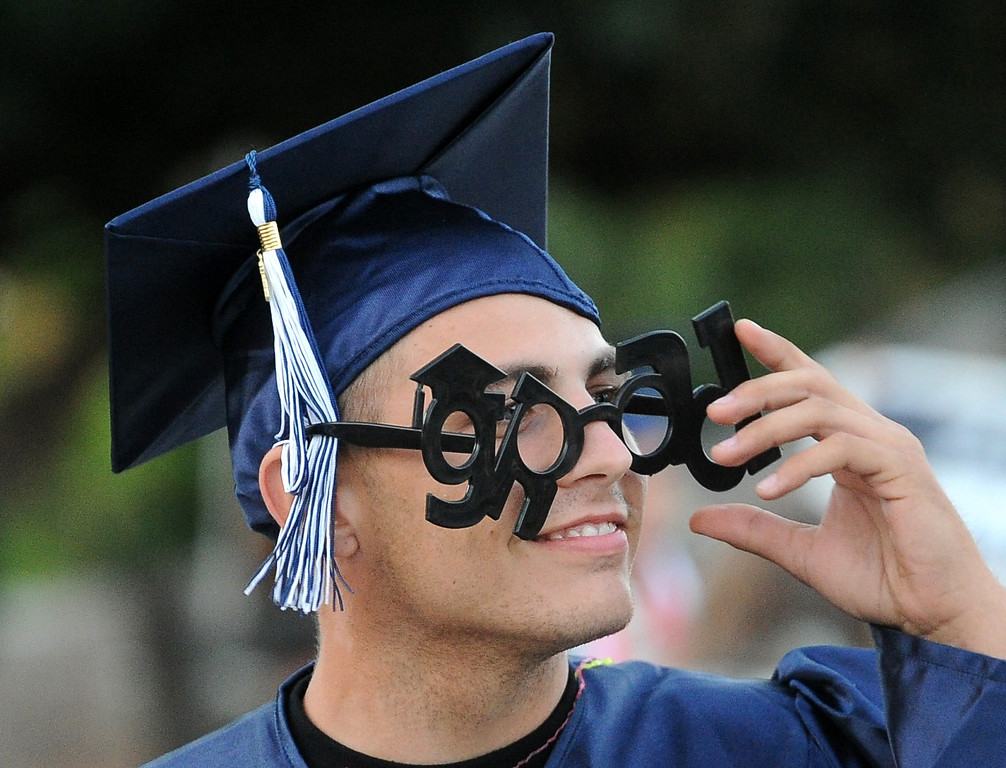 ". Graduate Timothy Fleming, wears novelty ""grad\"" glasses during the commencement ceremony for Vicente-Martinez High School and Briones School in Martinez, Calif., on Wednesday, June 5, 2013. The graduation also featured class speeches by graduates Maalec Thomas and Serenity McGill, a performance by graduate Nicholas Napolitano and scholarship presentations by Martinez organizations. (Doug Duran/Bay Area News Group)"