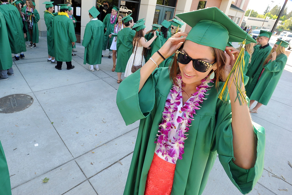 . San Ramon Valley High School graduate Veronica Wentker, 18, puts on her mortarboard before the start of the school\'s Commencement Ceremony in Danville, Calif., on Friday, June 14, 2013. (Doug Duran/Bay Area News Group)