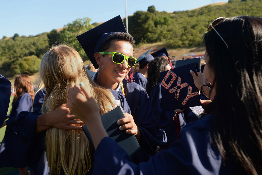 . Kevin Fong gets hugs following the 2013 Campolindo High School Commencement held on the Moraga, Calif., campus on Friday, June 7, 2013. (Dan Honda/Bay Area News Group)