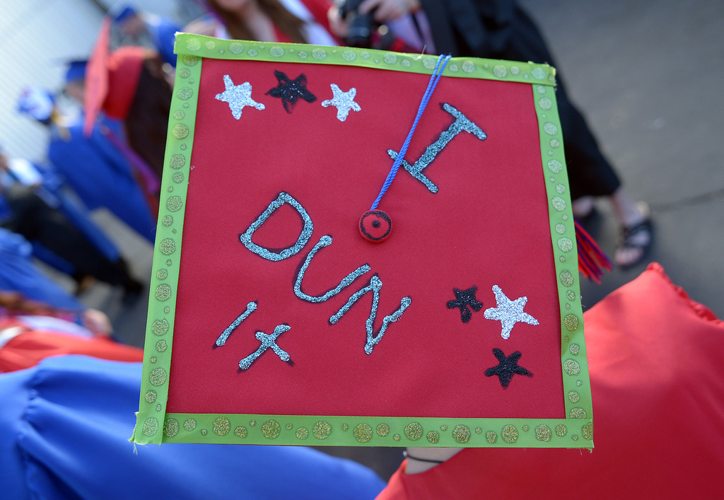 . Clayton Valley Charter High School student Samantha Pickolick, 18, shows off her spelling knowledge on her graduation cap during commencement ceremonies on Thursday, May 30, 2013 at Sleep Train Pavilion in Concord, Calif. (Jose Carlos Fajardo/Bay Area News Group)