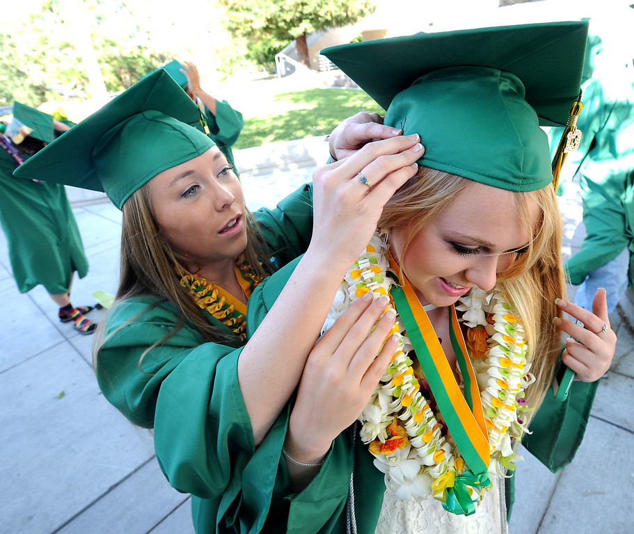 . San Ramon Valley High School graduate Taylor Talbot, 18, left, helps classmate Kate Steffy with her mortarboard before the start of the school\'s Commencement Ceremony in Danville, Calif., on Friday, June 14, 2013. (Doug Duran/Bay Area News Group)
