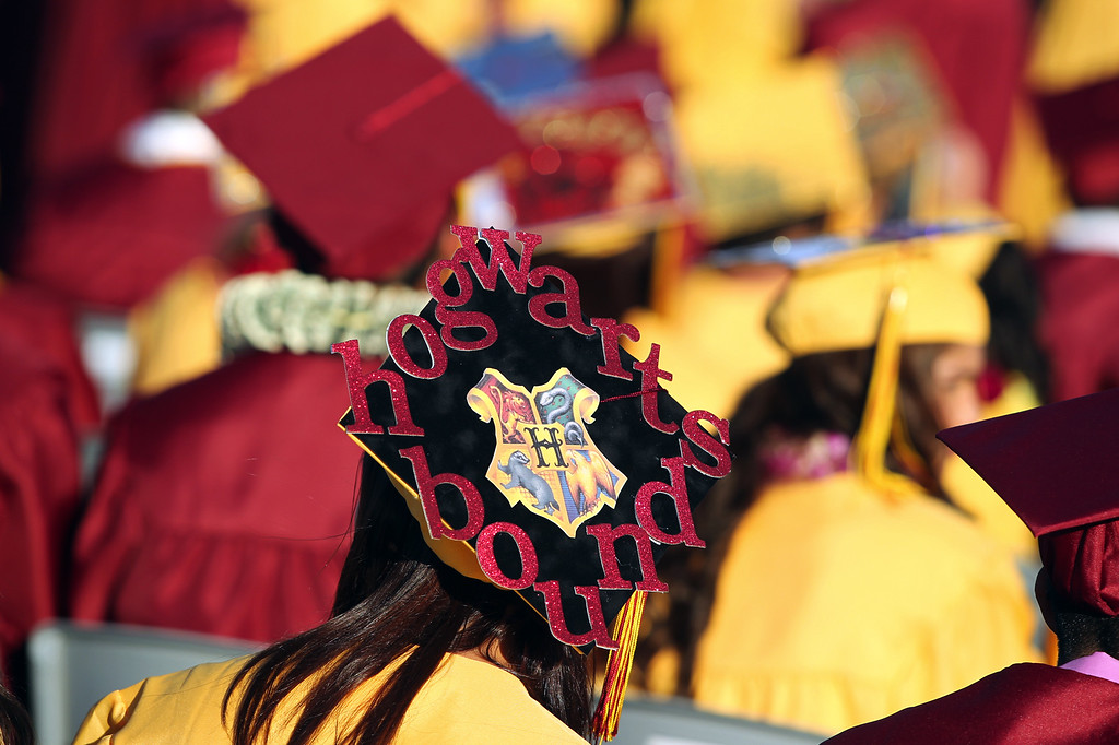 . Bryanna Souza, 18, wears a decorated cap as she participates in the Liberty High School Class of 2013 commencement ceremony on the school\'s Ohmstede Field in Brentwood, Calif., on Friday, June 7, 2013. (Anda Chu/Bay Area News Group)