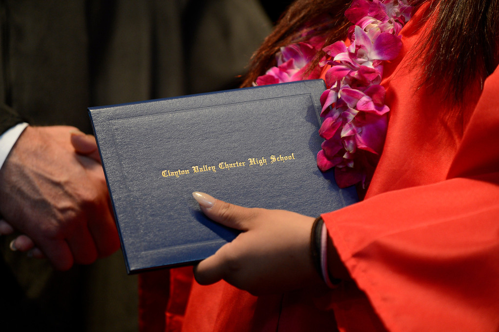 . A Clayton Valley Charter High School student receives her diploma cover during commencement ceremonies on Thursday, May 30, 2013 at Sleep Train Pavilion in Concord, Calif. (Jose Carlos Fajardo/Bay Area News Group)