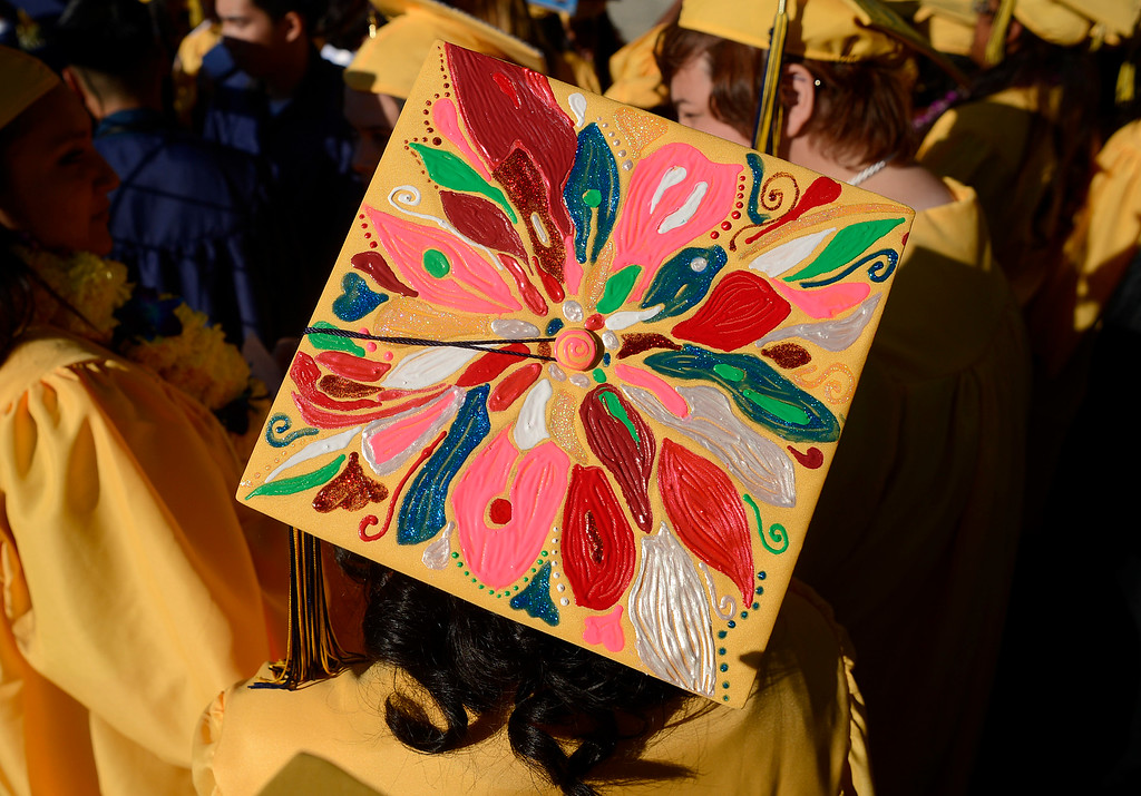 . Ygnacio Valley High School student Andrea Beltran, 18, wears her hand painted cap before commencement ceremonies at Sleep Train Pavilion in Concord, Calif., on Thursday, June 13, 2013. (Jose Carlos Fajardo/Bay Area News Group)