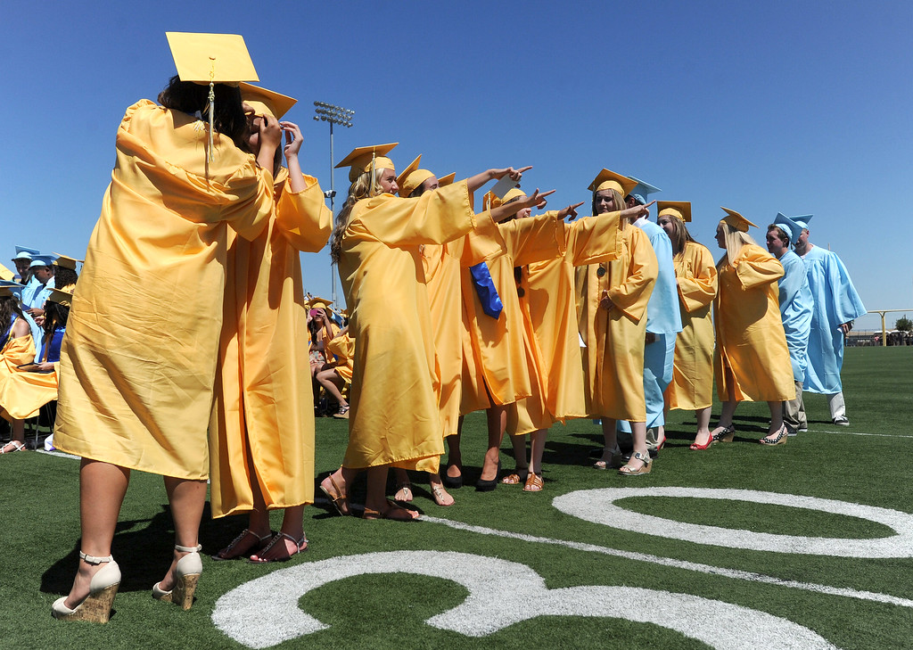 . Graduates find friends and family in the stands as they line up to receive their diplomas at the Heritage High School graduation ceremony held at Patriot Stadium on the campus of Heritage High School in Brentwood, Calif., on Saturday, June 8, 2013. (Dan Honda/Bay Area News Group)