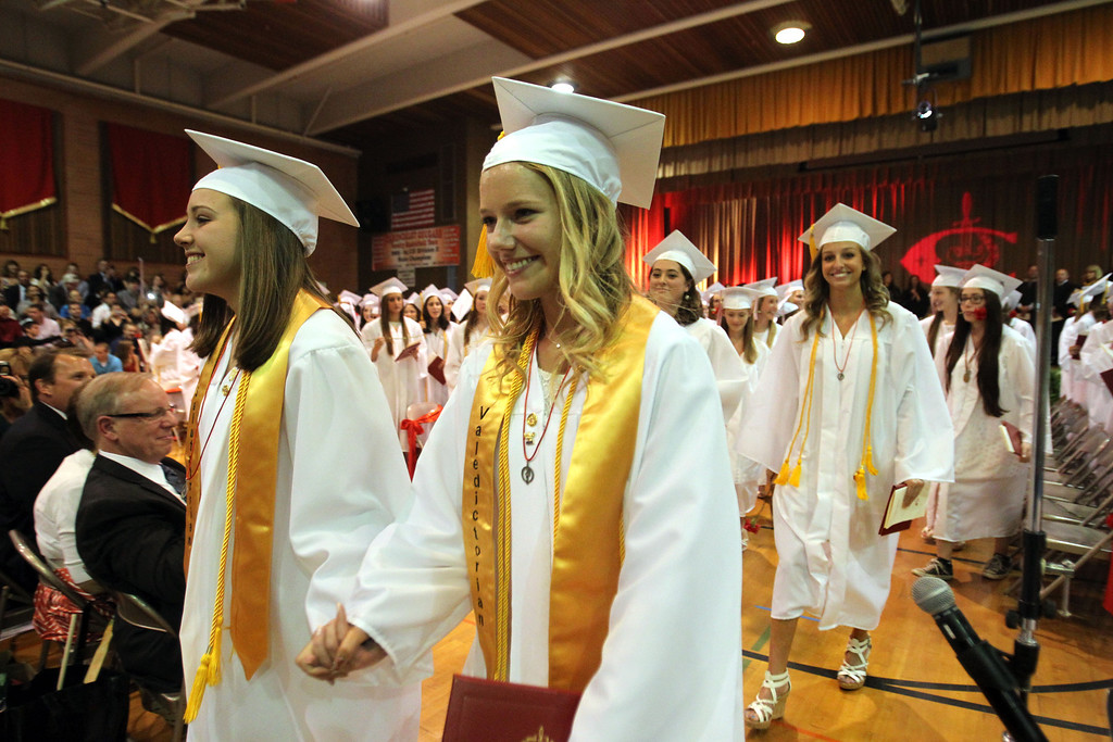 . Carondelet High School Salutatorian Laura Bobich , left, and Valedictorian Alyssa McHugh lead the recessional of the Class of 2013 at the conclusion of their commencement ceremony at Carondelet High School in Concord, Calif., on Sunday, May 19, 2013. (Ray Chavez/Bay Area News Group)