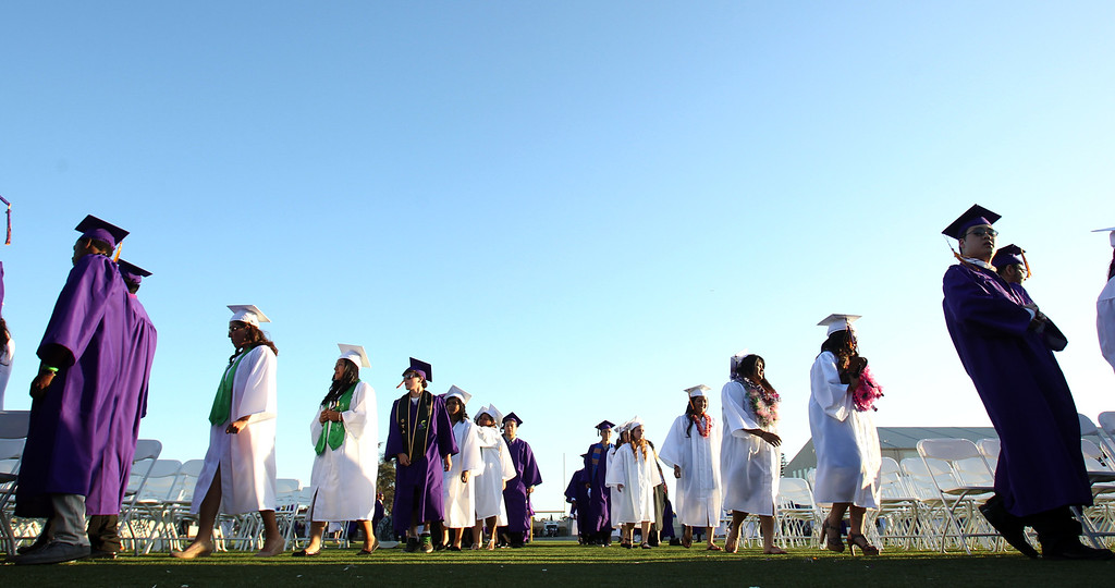 . Kennedy High School graduates march into their commencement ceremony in Fremont, Calif., on Wednesday, June 19, 2013. (Anda Chu/Bay Area News Group)