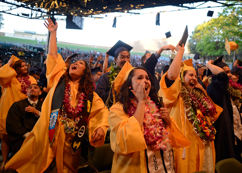 . Ygnacio Valley High School students toss their caps into the air at the end of commencement ceremonies at Sleep Train Pavilion in Concord, Calif., on Thursday, June 13, 2013. (Jose Carlos Fajardo/Bay Area News Group)