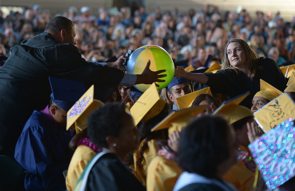 . Teachers capture a beach ball during commencement ceremonies at Sleep Train Pavilion in Concord, Calif., on Thursday, June 13, 2013. (Jose Carlos Fajardo/Bay Area News Group)