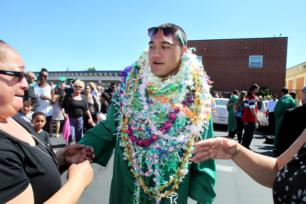 . Mui Vitale, left,  gets emotional as she congratulates her son and De La Salle graduate Pepe Viatle followeing his commencement ceremony of the Class of 2013 at De La Salle High School in Concord, Calif., on Sunday, May 19, 2013. (Ray Chavez/Bay Area News Group)