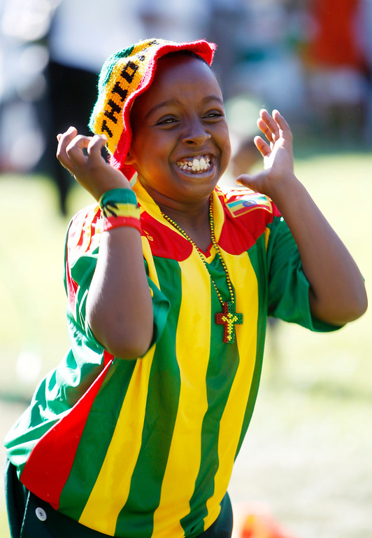 ". Santa Clara resident Natnaiel Yishak, 10, reacts as he plays in the children area during the Ethiopian ""Enkutatash\""  new year celebration at Guadalupe River Park Arena Green West in downtown San Jose, Calif., on Sunday, Sept. 8, 2013. (Josie Lepe/Bay Area News Group)"