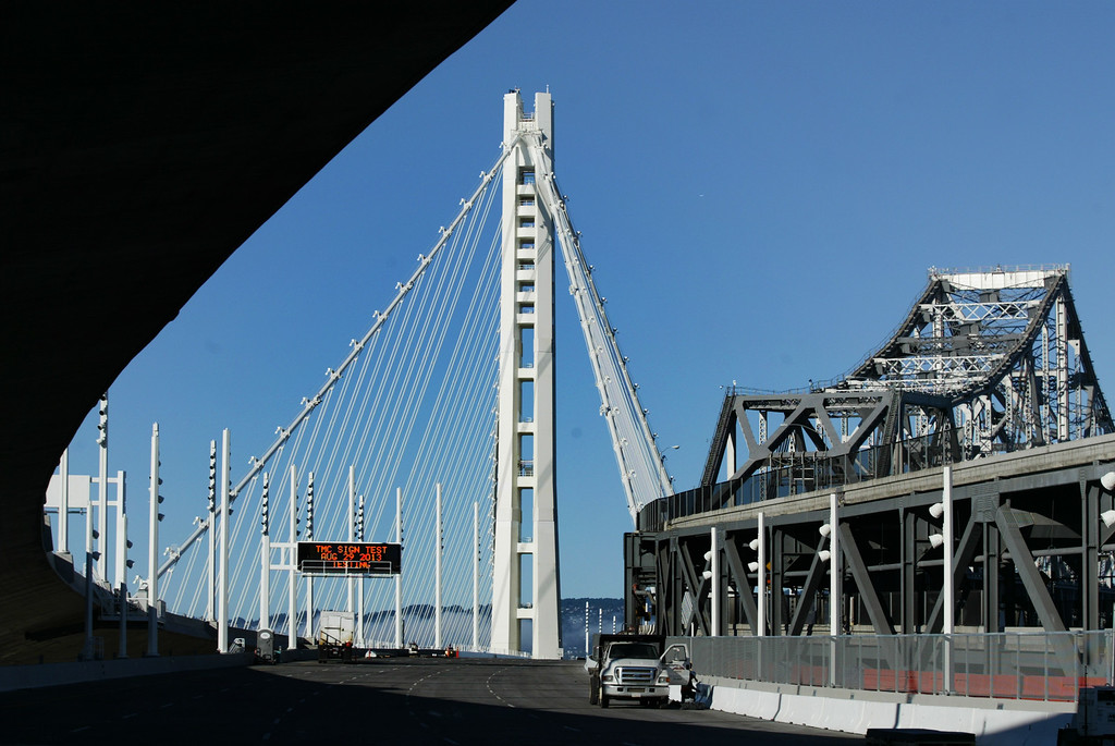 . The new and old eastern spans of the Bay Bridge seen after coming out of the tunnel from San Francisco, Calif., on Thursday, Aug. 30, 2013. The new eastern span is scheduled to open on Tuesday, September 3, at 5 a.m. (Ray Chavez/Bay Area News Group)