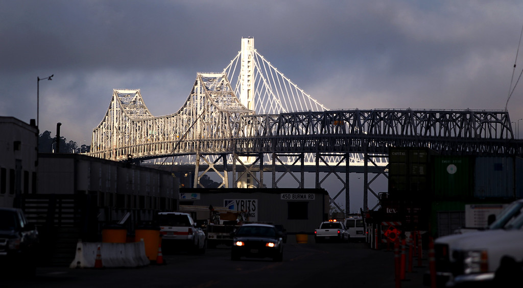 . Both the old and new eastern spans of the Bay Bridge are seen from Burma Road in Oakland, Calif., on Saturday, Aug. 31, 2013. According to Caltrans, progress continues to remain on schedule on the third day of the bridge closure. (Anda Chu/Bay Area News Group)